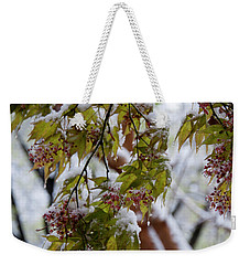 Weekender Tote Bag featuring the photograph snow on the Cherry blossoms by Chris Flees