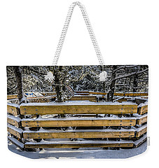 Weekender Tote Bag featuring the photograph Snow On The Fence by Bill Howard