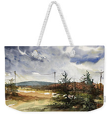 Snow Sky In Fall Weekender Tote Bag by Judith Levins