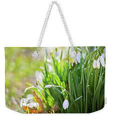 Weekender Tote Bag featuring the photograph Snowdrops by Rima Biswas