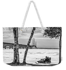 Weekender Tote Bag featuring the photograph Snowmobile Michigan Black And White  by John McGraw