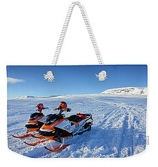 Weekender Tote Bag featuring the photograph Snowmobiles In Iceland In Winter by Matthias Hauser