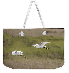 Snowy Egret Pair Flying Across A Plain Weekender Tote Bag
