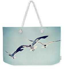 Weekender Tote Bag featuring the photograph Soaring Seagulls by Trish Mistric
