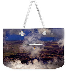 Weekender Tote Bag featuring the photograph Soaring Through The Clouds by Susan Rissi Tregoning