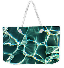 Weekender Tote Bag featuring the photograph Solid  by Joel Loftus