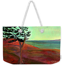 Weekender Tote Bag featuring the painting Solitary Pine by Claire Bull