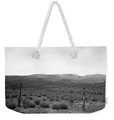 Weekender Tote Bag featuring the photograph Solitude by Eric Christopher Jackson