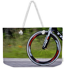Weekender Tote Bag featuring the photograph Speed Of Life by Linda Unger