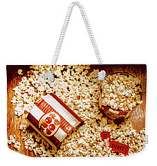 Weekender Tote Bag featuring the photograph Spilt Tubs Of Popcorn And Movie Tickets by Jorgo Photography - Wall Art Gallery