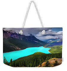 Weekender Tote Bag featuring the photograph  Spirit Of The Wolf by John Poon