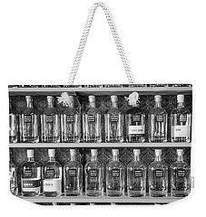 Weekender Tote Bag featuring the photograph Spirit World Bottles by T Brian Jones