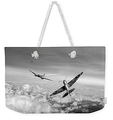 Weekender Tote Bag featuring the photograph Spitfire Attacking Heinkel Bomber Black And White Version by Gary Eason