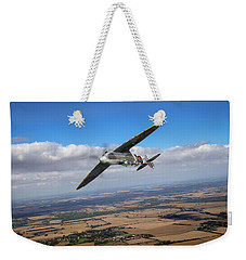 Weekender Tote Bag featuring the photograph Spitfire Tr 9 On A Roll by Gary Eason
