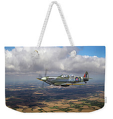 Weekender Tote Bag featuring the photograph Spitfire Tr 9 Sm520 by Gary Eason