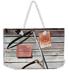 Weekender Tote Bag featuring the photograph Spitting Prohibited by Ivana Westin