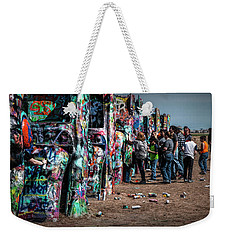 Weekender Tote Bag featuring the photograph Spray Paint Fun At Cadillac Ranch by Randall Nyhof