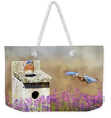 Weekender Tote Bag featuring the photograph Spring Builders by Lori Deiter