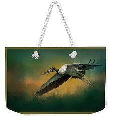 Weekender Tote Bag featuring the photograph Spring Flight by Marvin Spates