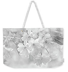 Weekender Tote Bag featuring the photograph Spring Flower Blossoms Soft Gray by Jennie Marie Schell