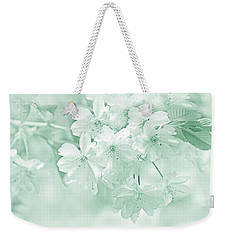 Weekender Tote Bag featuring the photograph Spring Flower Blossoms Teal by Jennie Marie Schell