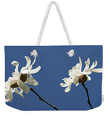Weekender Tote Bag featuring the photograph Spring Magnolias by Haleh Mahbod