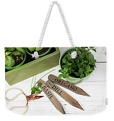 Weekender Tote Bag featuring the photograph Spring Plants by Rebecca Cozart