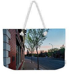 Weekender Tote Bag featuring the photograph St. Anne Street At Dusk by Darcy Michaelchuk