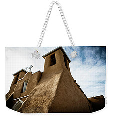 Weekender Tote Bag featuring the photograph St. Francis Church Taos by Marilyn Hunt