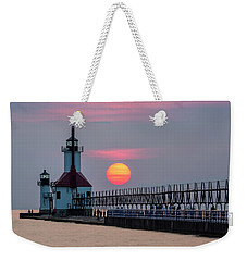 Weekender Tote Bag featuring the photograph St. Joseph Lighthouse At Sunset by Adam Romanowicz