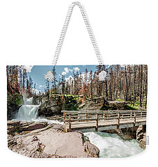 Weekender Tote Bag featuring the photograph St. Mary Falls With Bridge by Margaret Pitcher