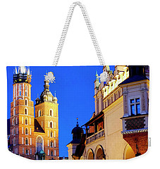 Weekender Tote Bag featuring the photograph St. Mary's Basilica And Cloth Hall by Fabrizio Troiani