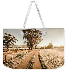 Weekender Tote Bag featuring the photograph St Marys Winter Country Road by Jorgo Photography - Wall Art Gallery