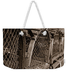 Weekender Tote Bag featuring the photograph Stacks Of Pei Loberster Traps by Chris Bordeleau