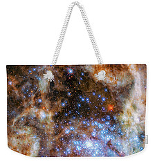 Weekender Tote Bag featuring the photograph Star Cluster R136 by Marco Oliveira