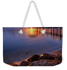 Weekender Tote Bag featuring the photograph Starburst Sunset Over House Of Refuge Pier In Hutchinson Island At Jensen Beach, Fla by Justin Kelefas