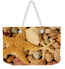 Weekender Tote Bag featuring the photograph Starfish And Seashells by Angie Tirado