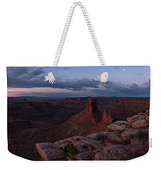 Weekender Tote Bag featuring the photograph Statues In The Desert by Dustin LeFevre