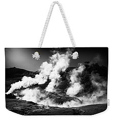 Weekender Tote Bag featuring the photograph Steaming Iceland Black And White Landscape by Matthias Hauser