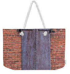 Weekender Tote Bag featuring the photograph Steel Shutters by Paul Freidlund