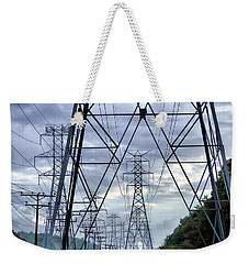 Weekender Tote Bag featuring the photograph Steel Soldiers Marching To The Sea by Brian Wallace