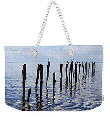 Weekender Tote Bag featuring the photograph Sticks Out To Sea by Stephen Mitchell