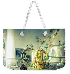 Weekender Tote Bag featuring the photograph Still, Life Goes On by Wayne Sherriff