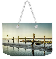 Weekender Tote Bag featuring the photograph Still Standing by Hannes Cmarits