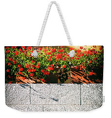 Weekender Tote Bag featuring the photograph Stone Bench With Flowers by Silvia Ganora