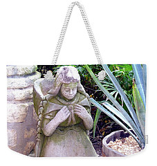 Weekender Tote Bag featuring the photograph Stone Girl With Basket And Plants by Francesca Mackenney