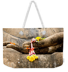 Weekender Tote Bag featuring the photograph Stone Hand Of Buddha by Adrian Evans