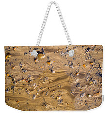 Weekender Tote Bag featuring the photograph Stones In A Mud Water Wash by John Williams