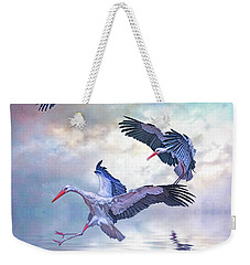 Weekender Tote Bag featuring the photograph Storks Landing by Brian Tarr