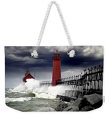 Storm At The Grand Haven Lighthouse Weekender Tote Bag by Randall Nyhof